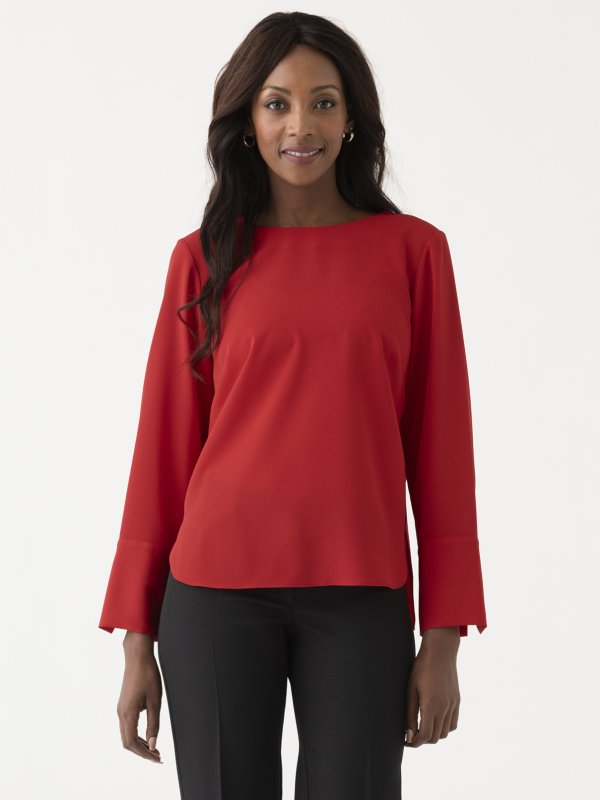 Classically styled , long sleeve , boxy top with a curved hem and wide cuff. Approx. 62cm centre back length