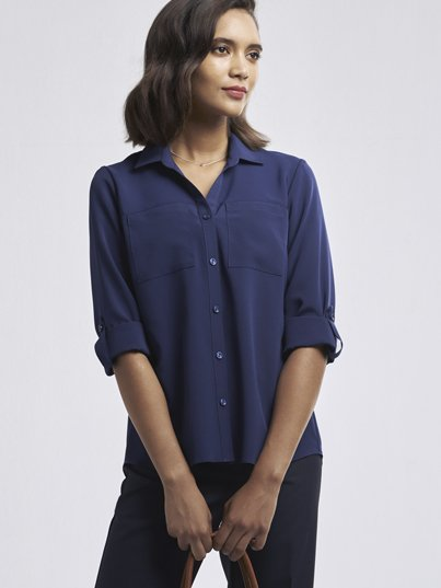 Relaxed fit , 2 pocket blouse, with a longer back and adjustable sleeve detail.  Approx. 71cm centre back length