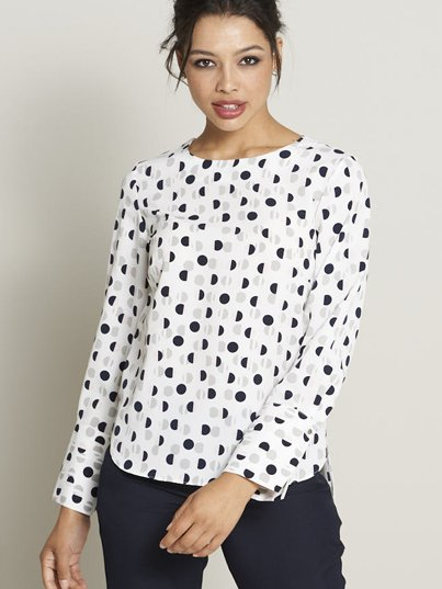 Classically styled , long sleeve , boxy top with a curved hem and wide cuff.