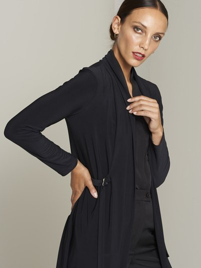 Classically styled, long sleeve , belted knit jacket